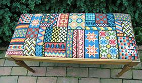 Sampler pattern on piano bench